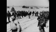 Allied soldiers marching on beach Stock Footage