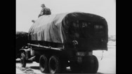 Military trucks moving on beach at Normandy Stock Footage