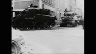 Military tanks moving on street at Normandy Stock Footage