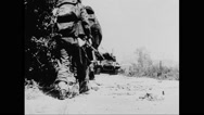 Allied soldiers marching on beach at Normandy Stock Footage