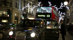 Man and woman board a black cab Regent street London Stock Footage