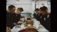 Servicemen praying before Thanksgiving Day dinner Stock Footage