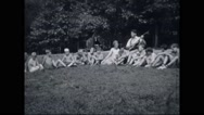 Boy campers listening music at campsite Stock Footage