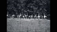 Girl campers exercising at campsite Stock Footage