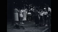 Women assisting girl campers to comb hair Stock Footage