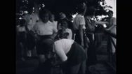 Girl campers stroking a dog at campsite Stock Footage