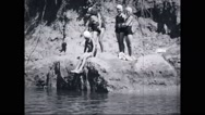 Girl campers jumping in river Stock Footage
