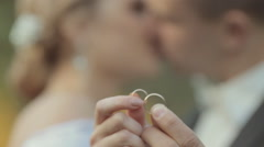 The newlyweds show their wedding gold rings Stock Footage