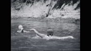 Girl campers swimming in river Stock Footage