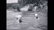 Girl campers swimming in lake Stock Footage