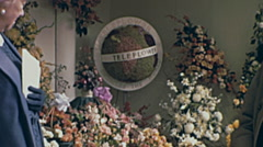 London 1960s: globe made of flower spinning at Chelsea flower show Stock Footage