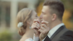 Newlyweds couple in love show their gold wedding rings Stock Footage