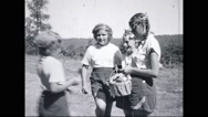 Girl campers at campsite Stock Footage