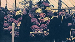 London 1960s: people visiting Chelsea flower show Stock Footage