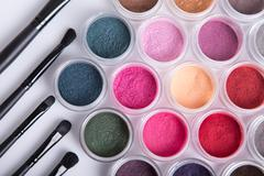 set of bright mineral eye shadows and brushes - stock photo