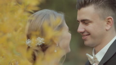 Affectionate bride corrects bow tie groom and they laughing Stock Footage