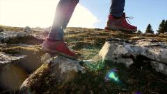 female hiker walking on rocky landscape. feet close up. sports activity - stock footage