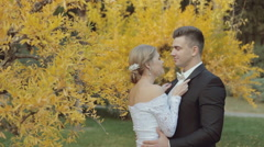 Lovely bride passionately kisses her young handsome groom Stock Footage