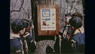 Students reading poster of forest fire prevention with logo of little Smokey Stock Footage