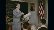 Teacher singing song of Smokey the bear along with students in school Stock Footage