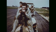 Ground crew playing harmonicas while delivering free fall bombs Stock Footage