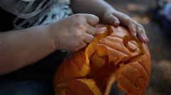 How to carve a pumpkin. - stock footage