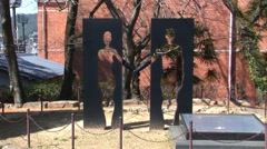 Japan Nagasaki peace park people Stock Footage