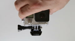 GoPro HERO4 Black Edition on white background Stock Footage