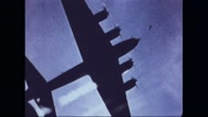 Motor of Boeing B-17 Flying Fortress emitting smoke while flying in sky Stock Footage
