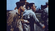 Ground crew playing games while waiting for the return of Boeing B-17 Stock Footage