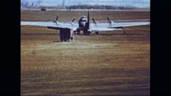 Red Cross ambulance moving towards Boeing B-17 Flying Fortress for assistance Stock Footage