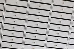 safe deposit boxes in a bank vault - stock photo