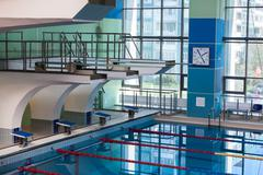 Diving boards into water in the swimming pool Stock Photos