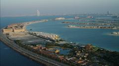 Stock Video Footage of Aerial Atlantis Hotel Burj Al Arab Dubai Palm Jumeirah UAE