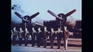 Crew of Memphis Belle standing in front of Flying Fortress Stock Footage