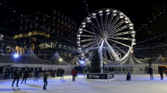 Skaters on the ice rink in Centenary Square,Birmingham, England. Stock Footage