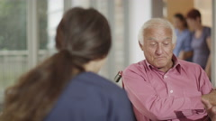 4K Caring nurse giving support to elderly male patient and his wife Stock Footage