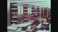 Shelves with data tapes and employee working on tax returns Stock Footage