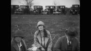 Guests having barbeque in lawn at General Billy Mitchell's barbeque farewell Stock Footage
