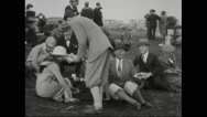 Lieutenant Phillips, Pete Melville, David C. Lingle and guests sitting in lawn Stock Footage