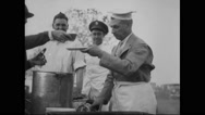 General Billy Mitchell serving barbecued beef to guest at farewell Stock Footage