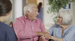 4K Caring nurse giving support to elderly male patient and his wife - stock footage