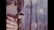 Aerosol spray being released into the test chamber Stock Footage