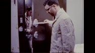Participants exit through door from test chamber Stock Footage
