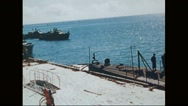View of harbour and Navy aircraft floating on ocean near Midway island Stock Footage