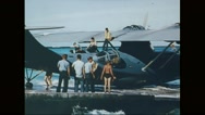 Navy aircraft being moved towards harbour and Marine corps marching on harbour Stock Footage