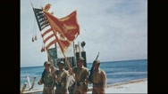 U.S Marine corps marching on harbour with flags Stock Footage