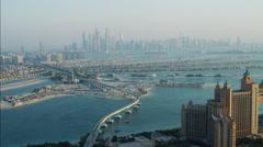 Stock Video Footage of Aerial Atlantis Hotel Resort Dubai City Palm Jumeirah UAE