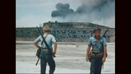 Marine corps standing in front of damaged hangar Stock Footage