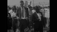 American protesters singing in Civil Rights March Stock Footage